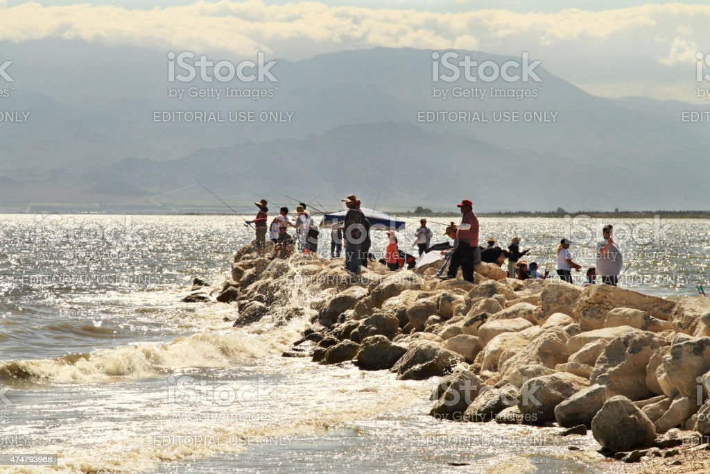 People fish at Salton Sea in California stock photo