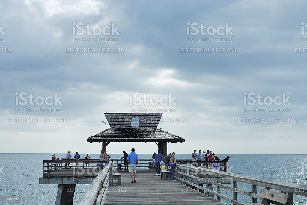People fish from Naples pier in southwest Florida stock photo
