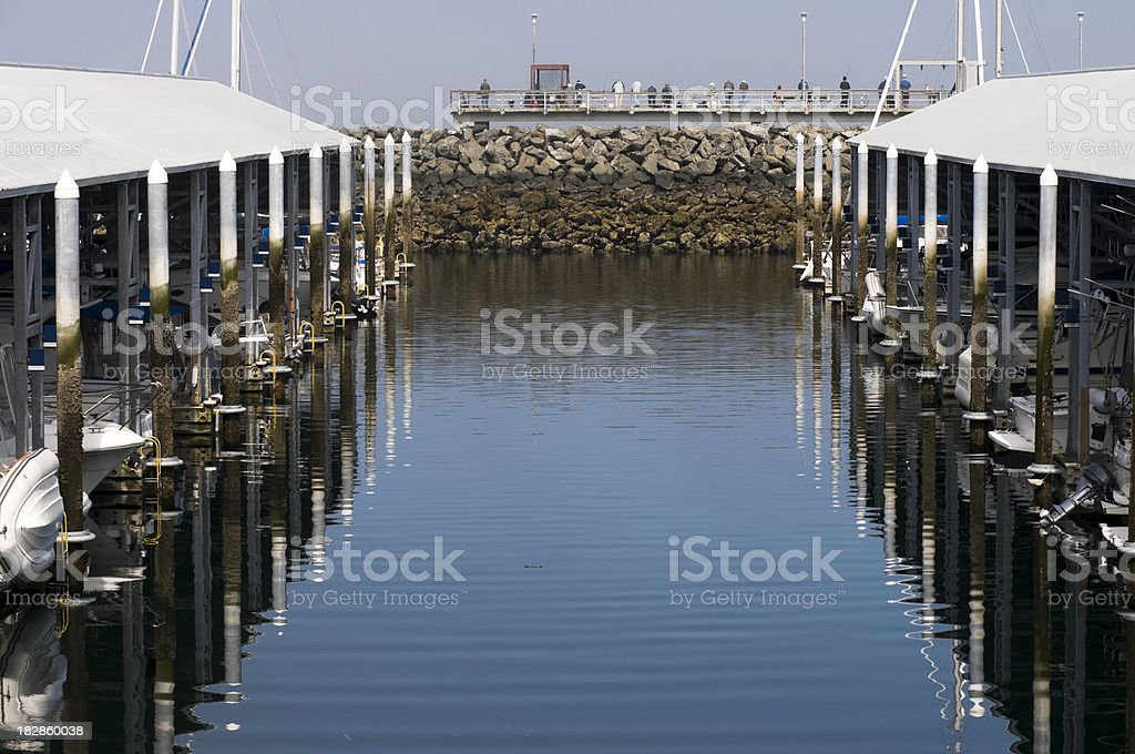 People fishing from public pier stock photo