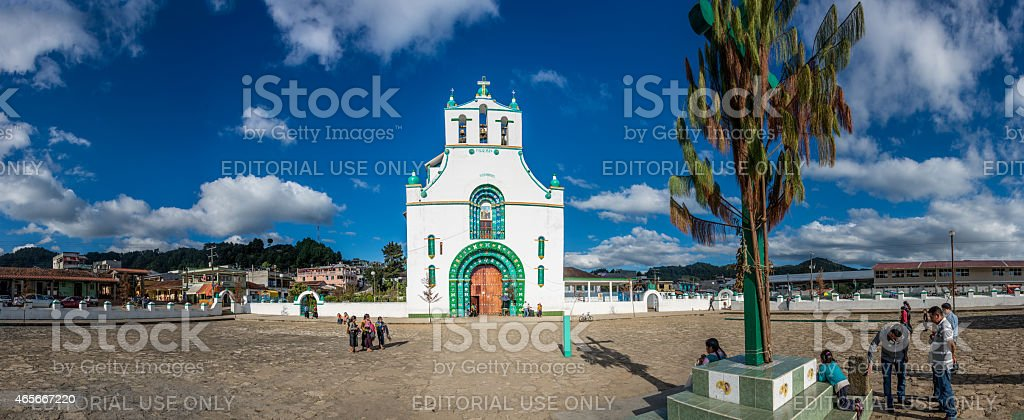 People gather around traditional church, Mexico. stock photo