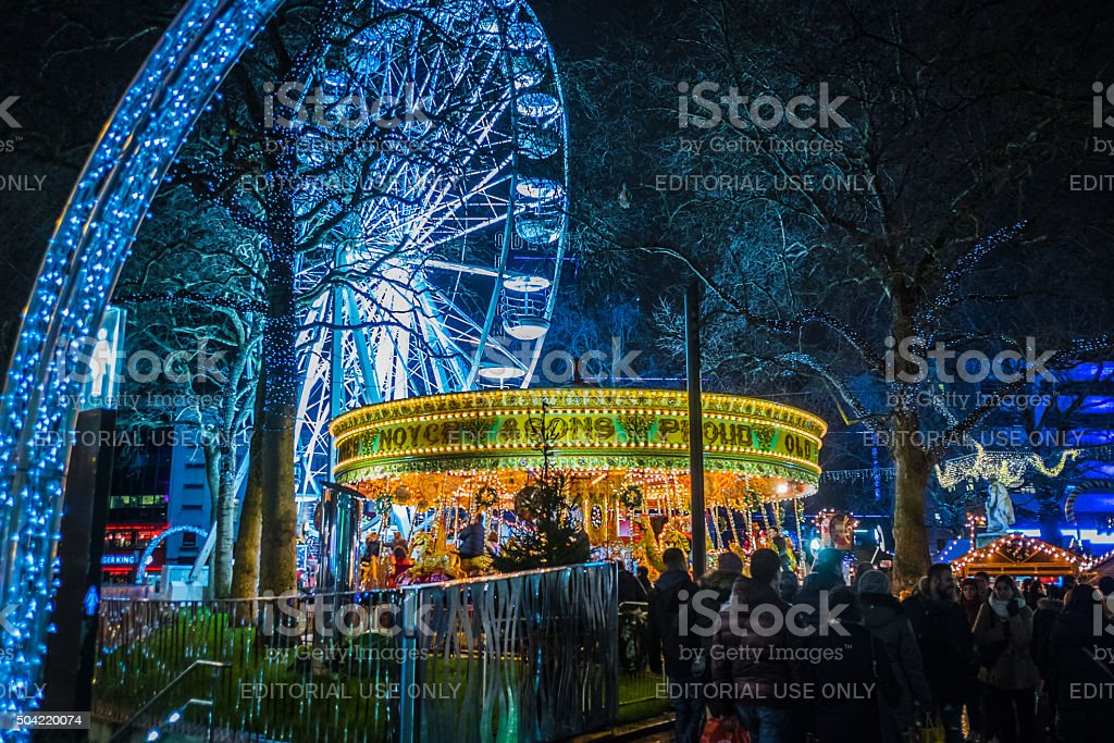 People gather in Leicester Square, London, at Christmas time stock photo