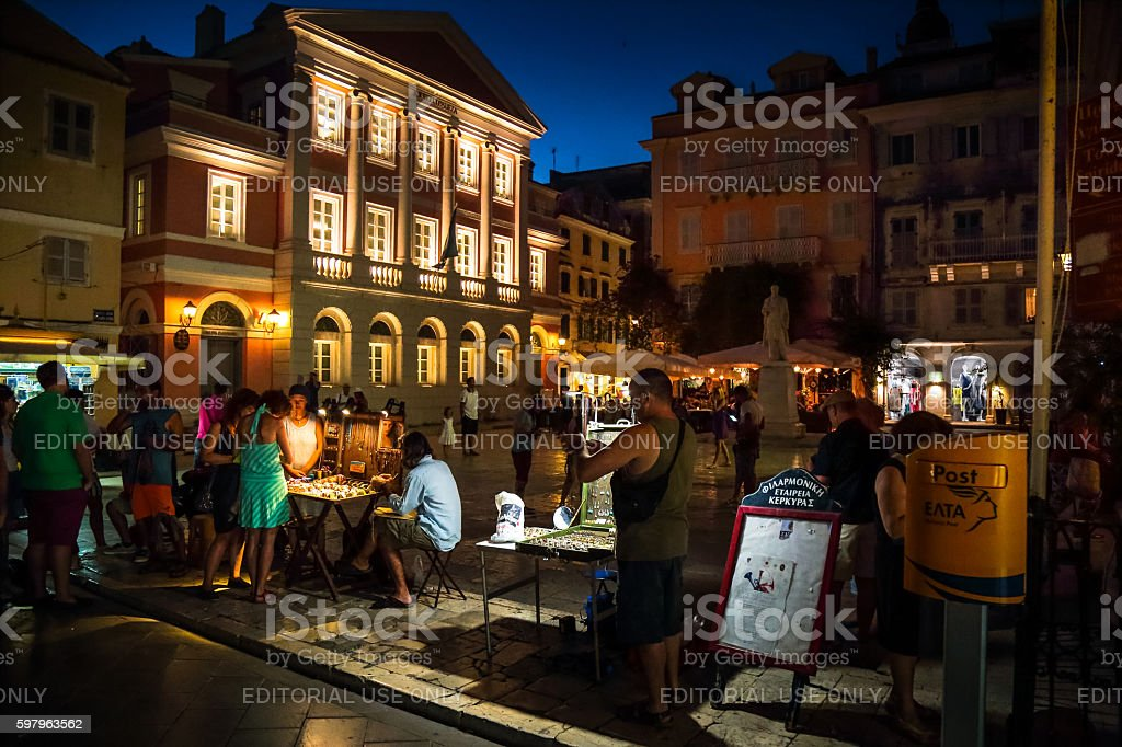 People gather to see  street artists and vendors, Corfu, Greece stock photo