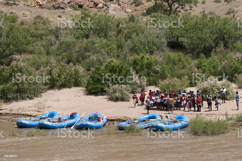 People gathering and receiving white water rafting instructions royalty-free stock photo
