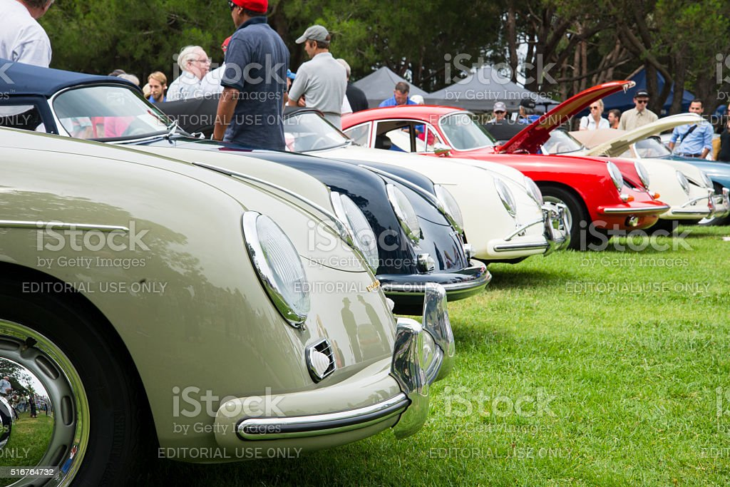 People Gathering Around Several Vintage Porsche Speedsters and 356's stock photo