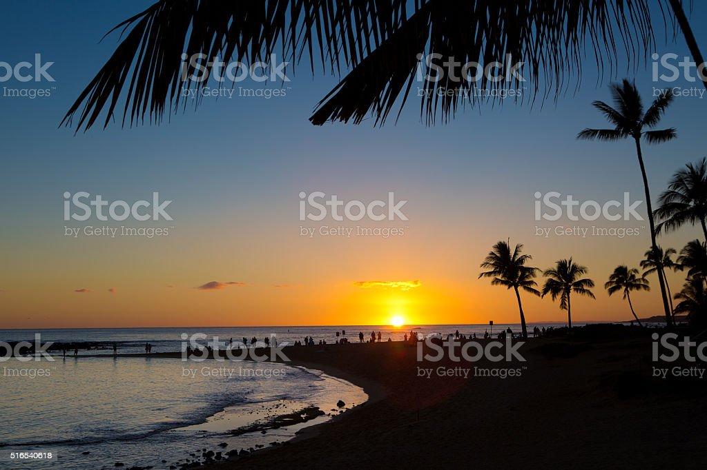 People Gathering at Beach Sunset in Tropical Vacation, Kauai, Hawaii stock photo