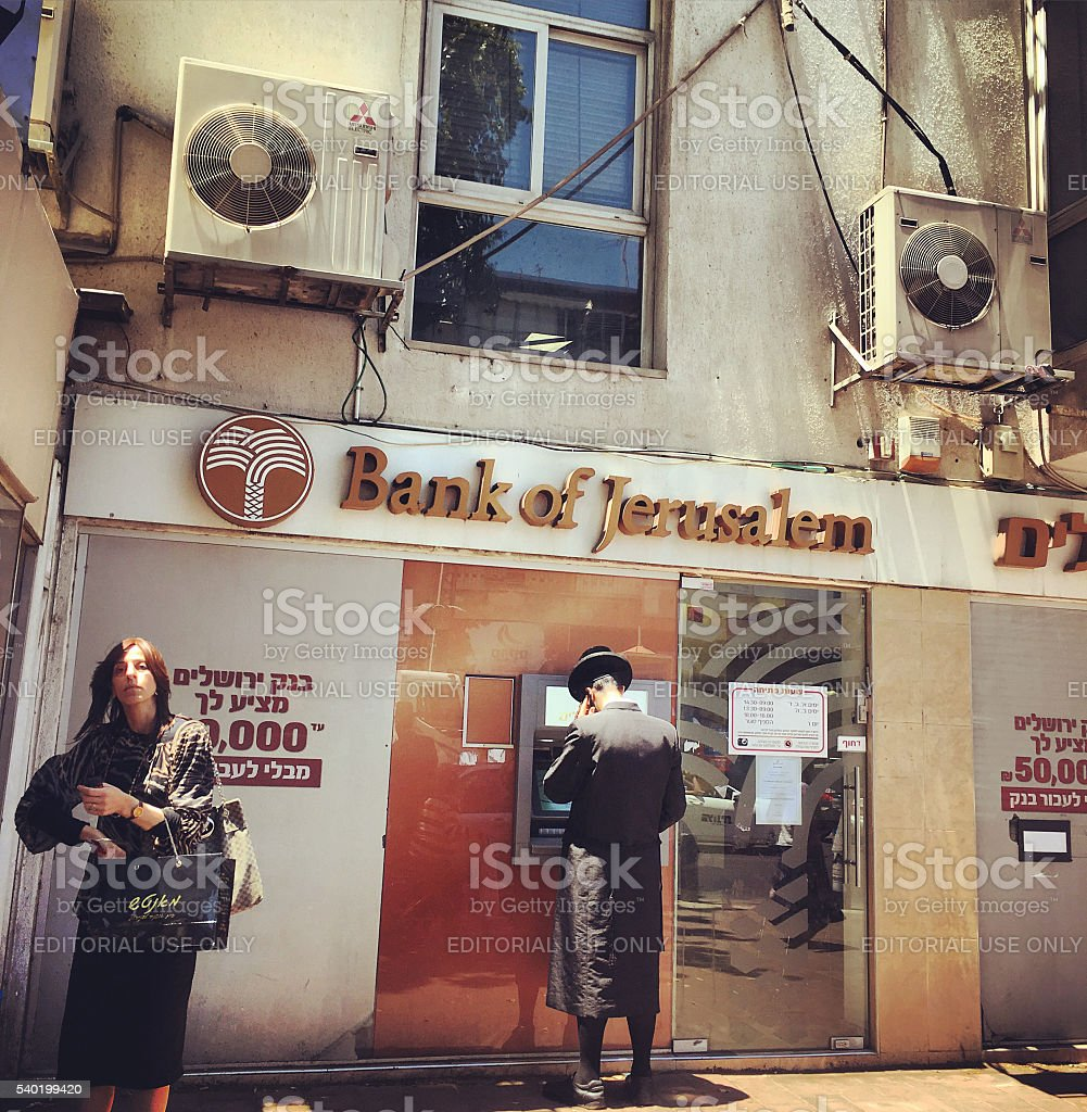 People getting cash from ATM, Bnei Brak, Israel stock photo