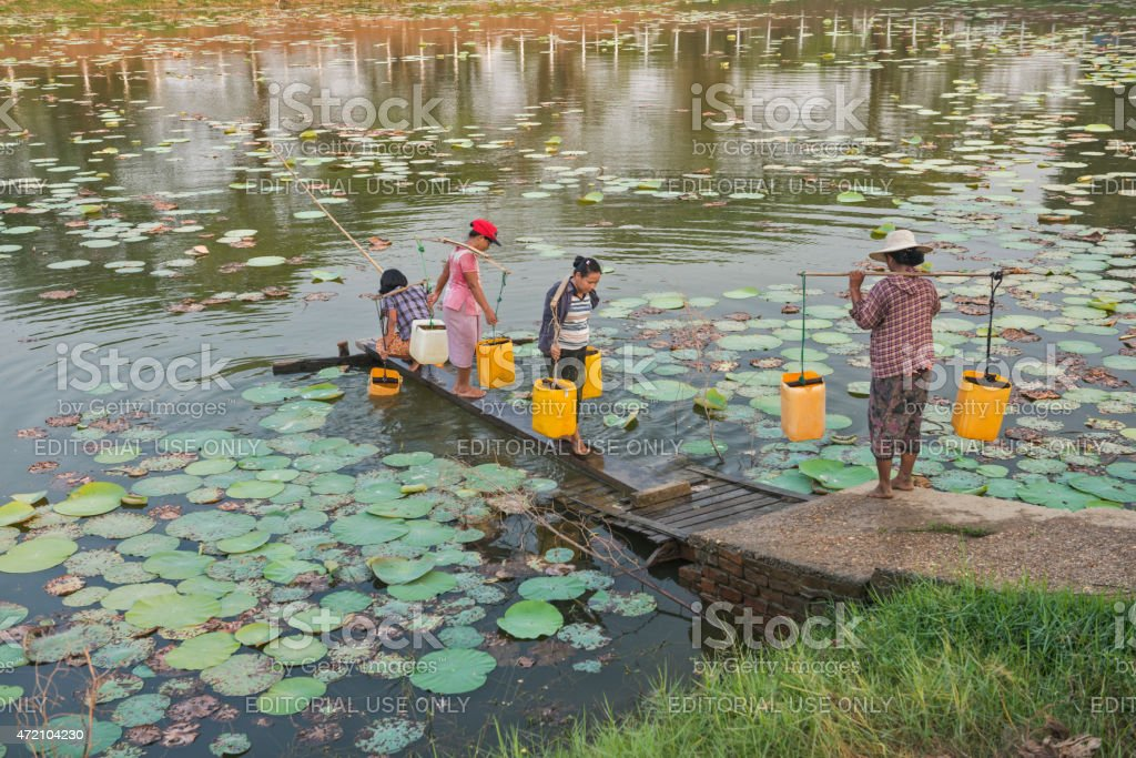 People Getting Drinking Water in Dala Myanmar stock photo