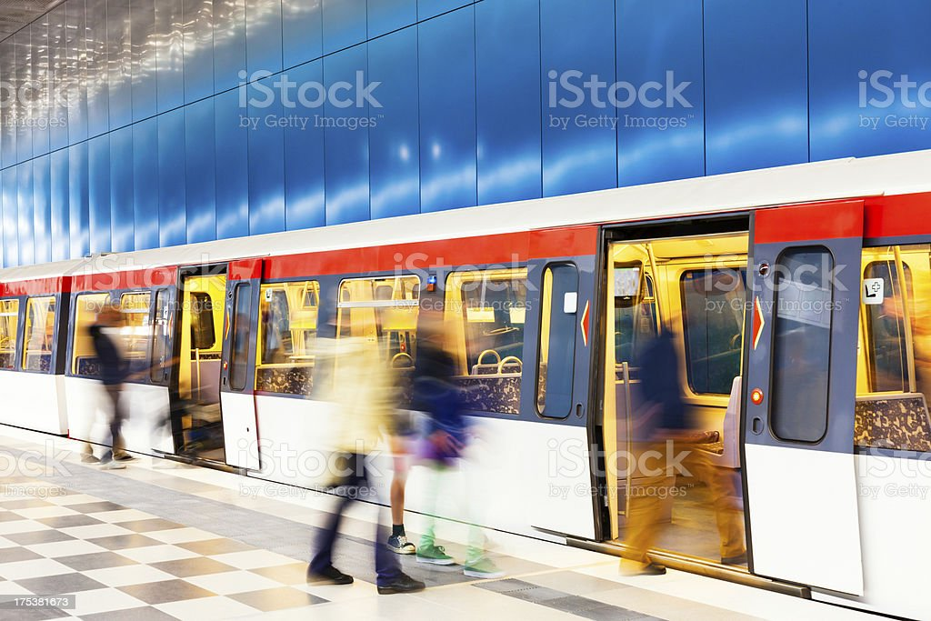 People Getting In Subway Train in Modern Underground Station royalty-free stock photo