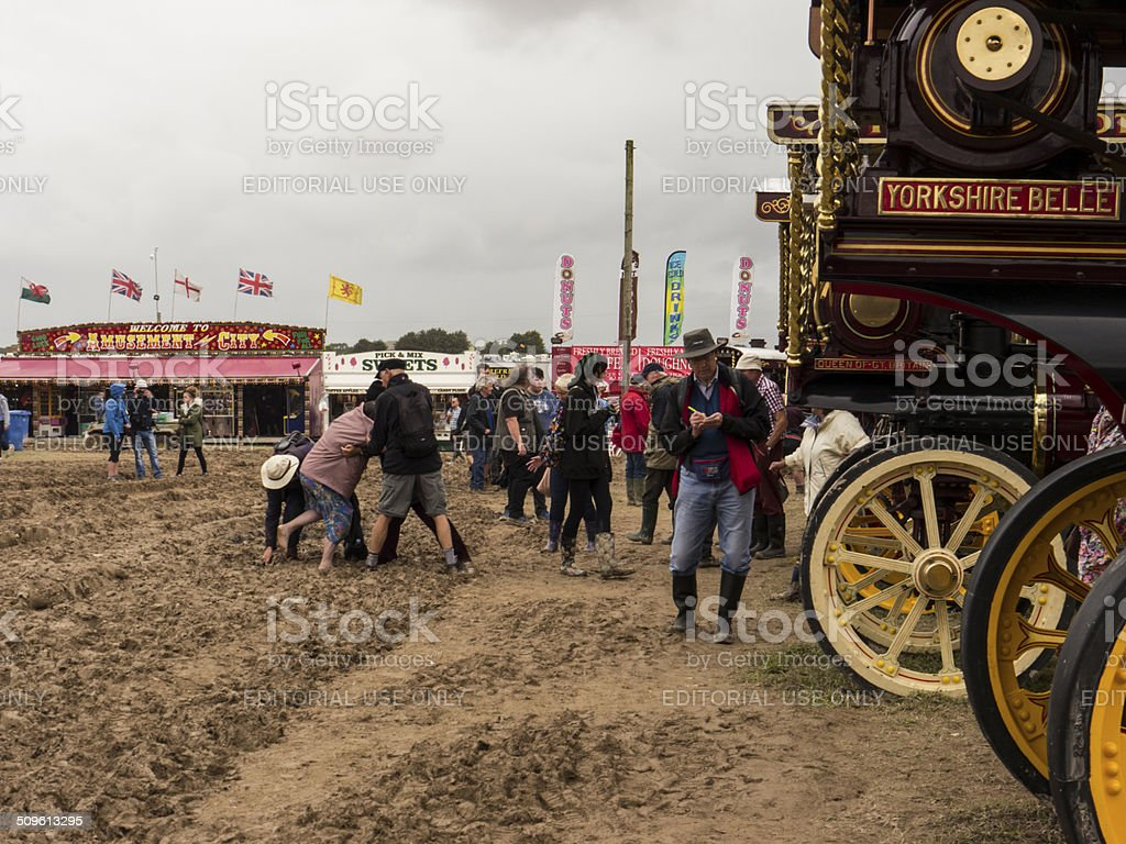 People getting stuck in mud at Steam Fair royalty-free stock photo