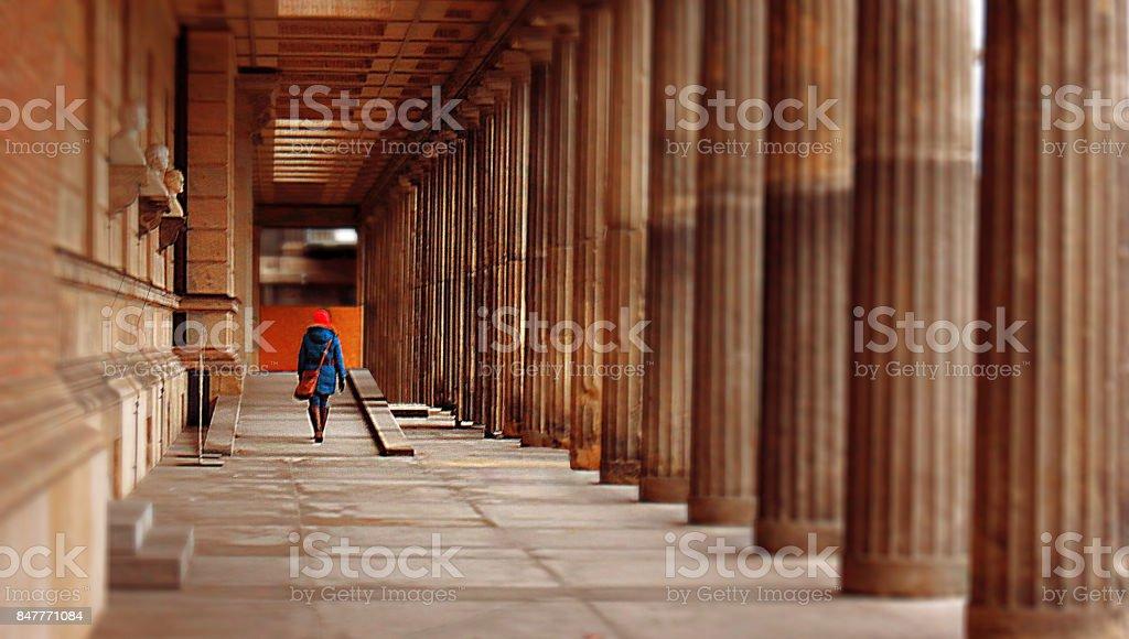People girl woman cityscape building walkway pavement pillars perspective urban stock photo