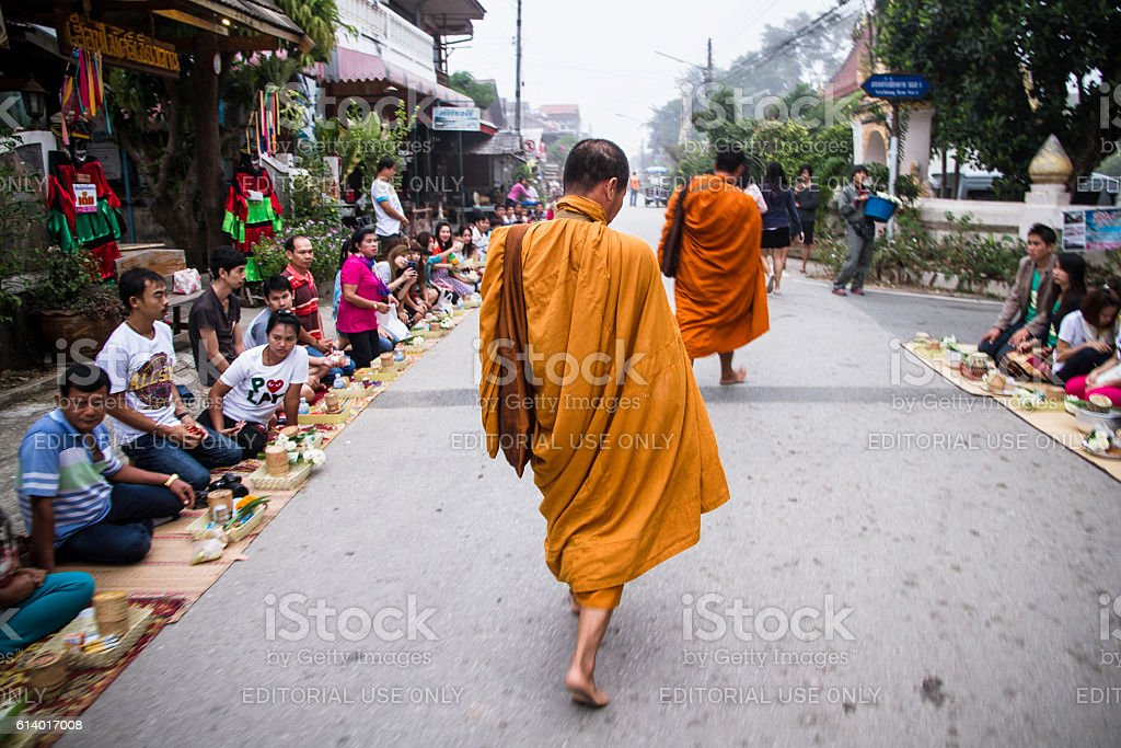 People give food and sticky rice to monks stock photo