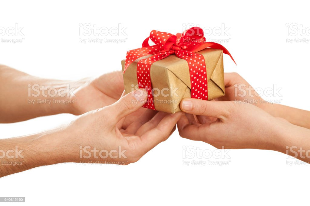 People giving gift in box stock photo