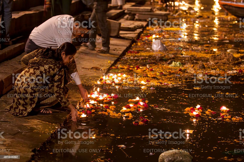 People giving Religious offerings and oil lamps, Varanasi, India stock photo