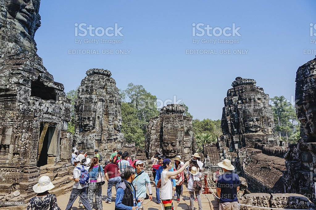 People go on sight-seeing in Bayon Temple royalty-free stock photo