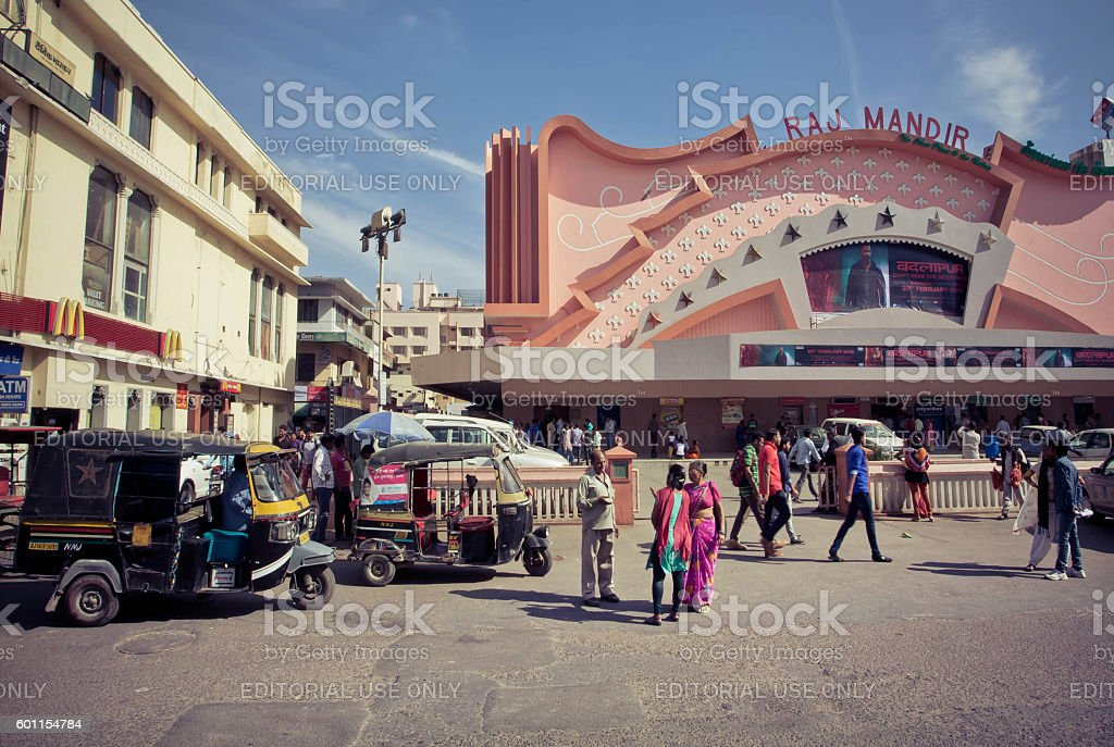 People going to a famous movie theater Raj Mandir stock photo