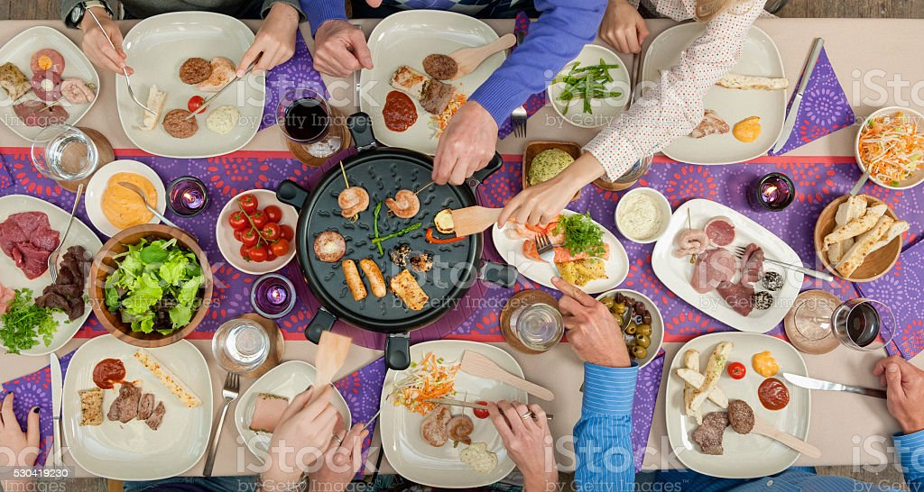 people grilling meat and seafood stock photo