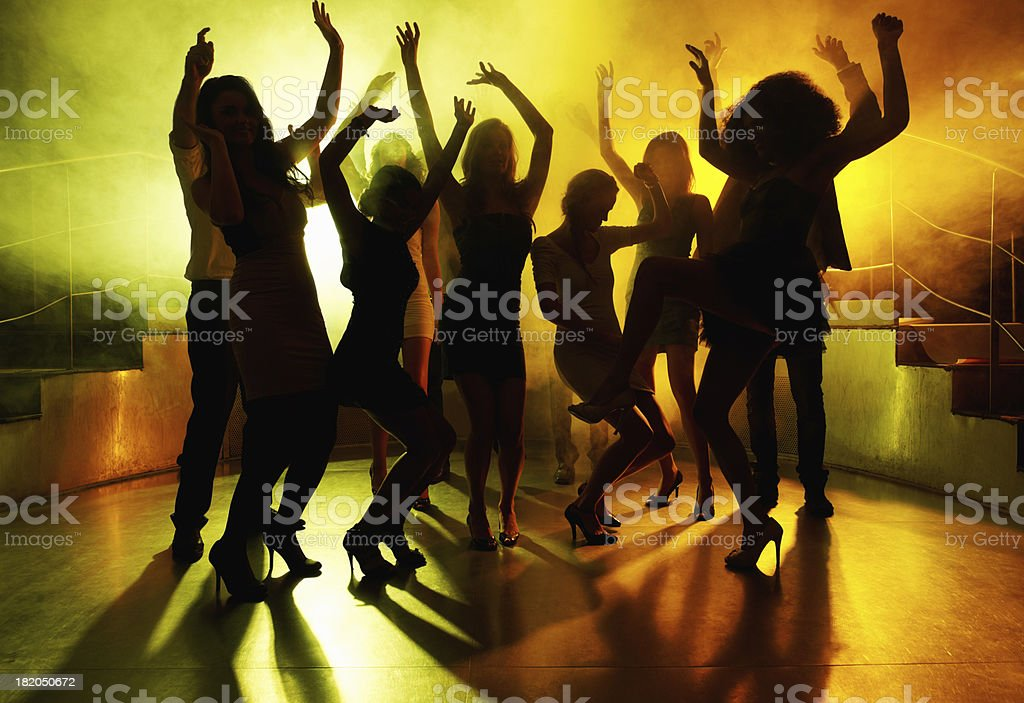 People grooving on dance floor at a night club stock photo