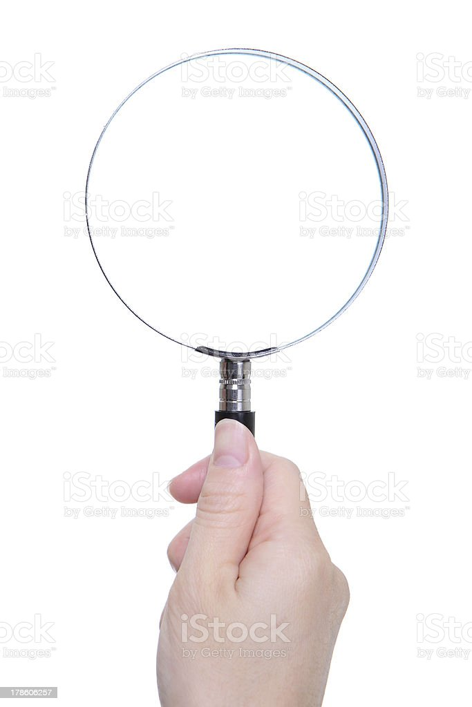 people hand holding classic magnifying glass royalty-free stock photo