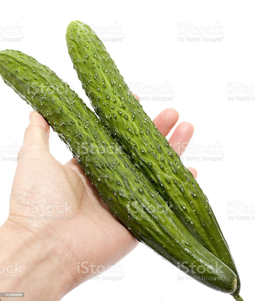 people hand taking two Cucumber royalty-free stock photo