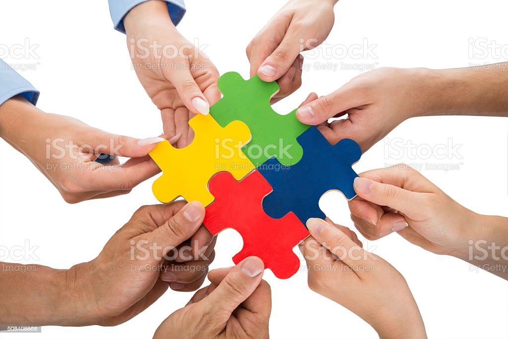 People Hands Connecting Jigsaw Pieces stock photo