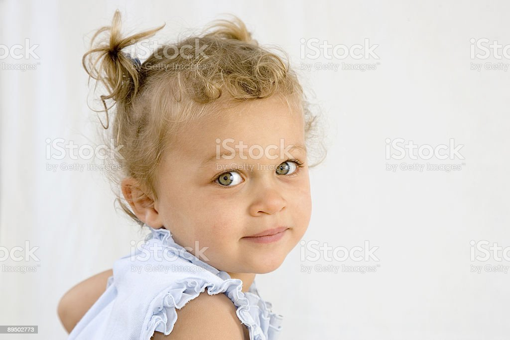People - Happy Toddler Looking Over Her Shoulder stock photo