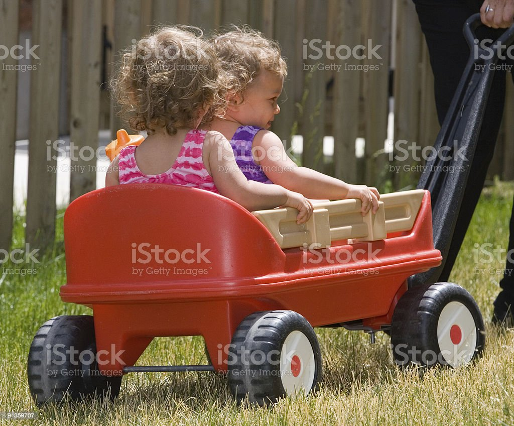 People - Happy Twin Toddlers Going For A Ride stock photo