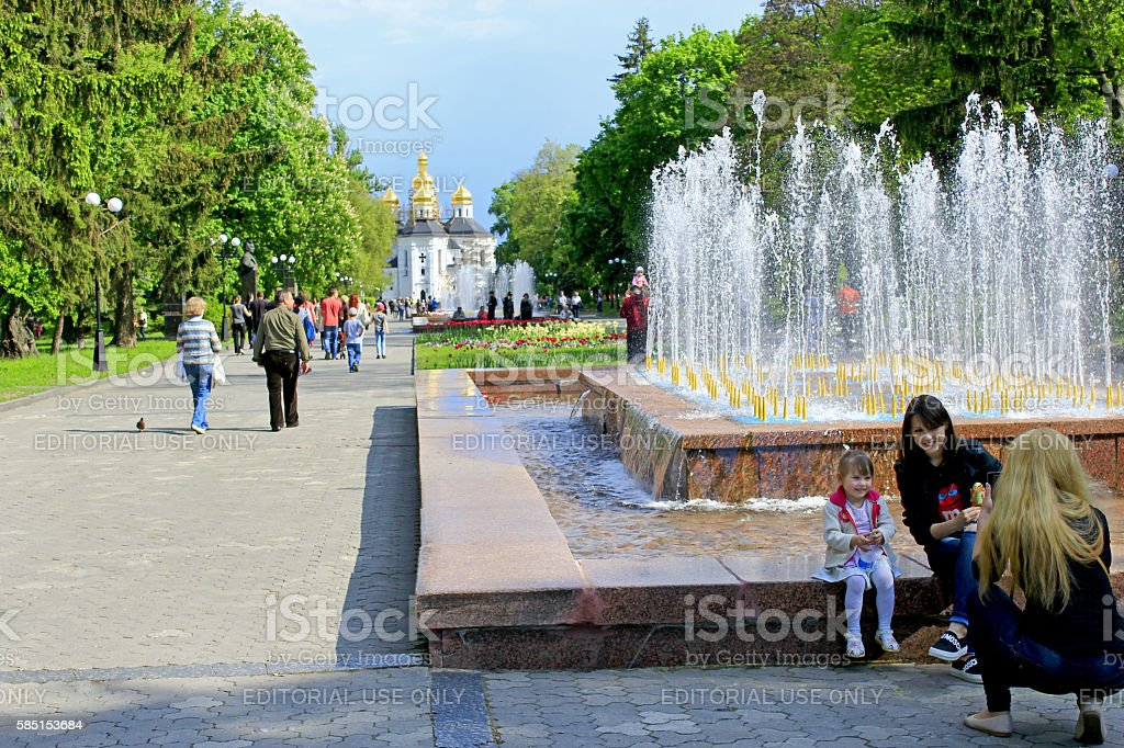 People have a rest in city park with fountains stock photo