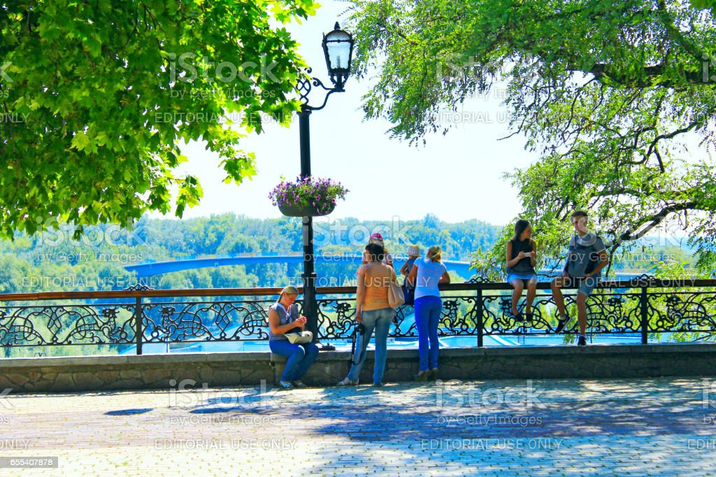people have a rest in the city park of Chernihiv stock photo
