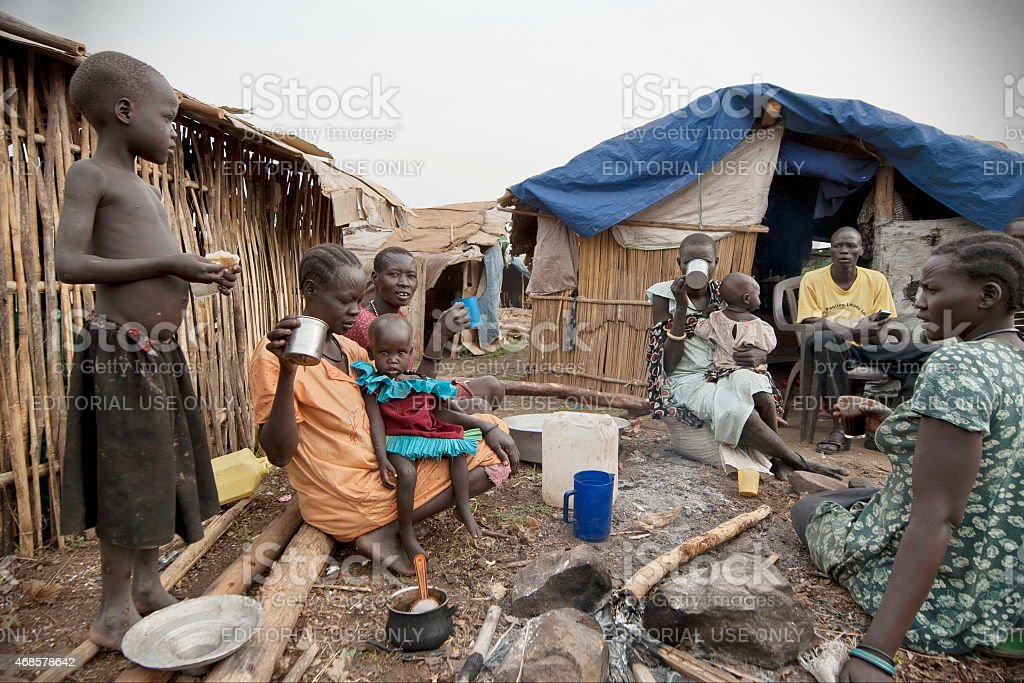 People have breakfast in displaced persons camp, Juba, South Sudan. stock photo