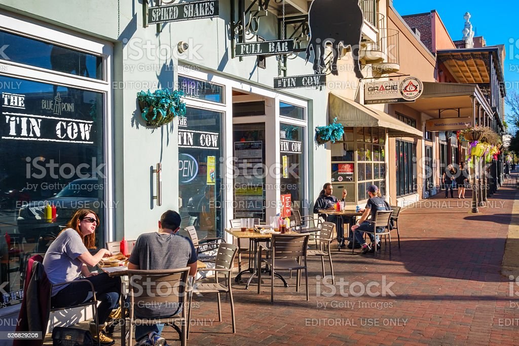 People Have Food at Restaurant Patio in Downtown Pensacola Florida stock photo