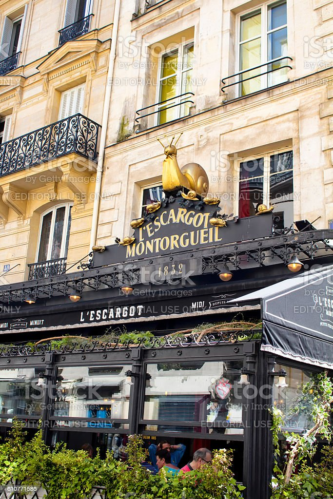 People have lunch at one of the traditional French bistro stock photo