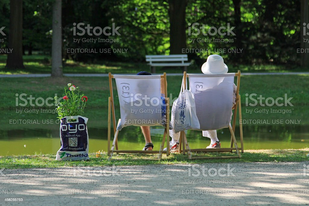 People having a break in folding chairs stock photo