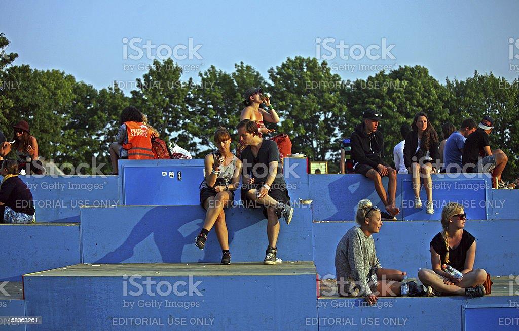 People having a break on Roskilde Festival square stock photo