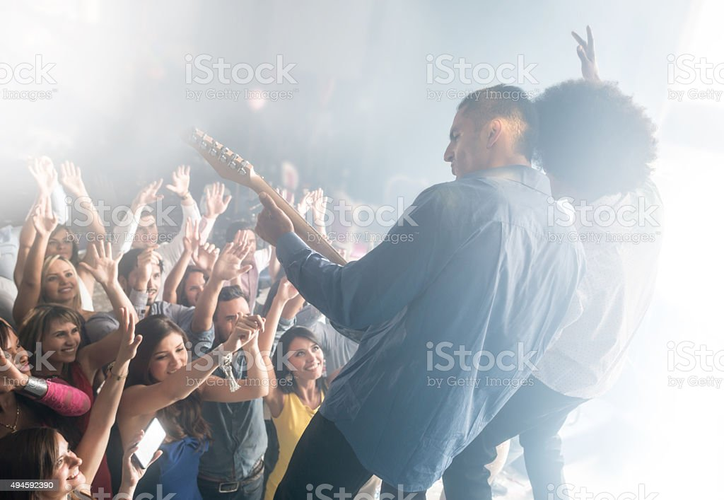 People having fun at a concert stock photo