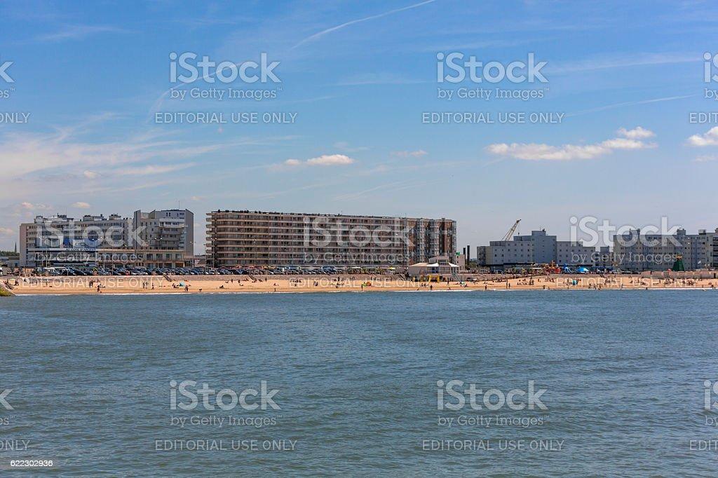 People having fun at sandy beach in calais france stock photo