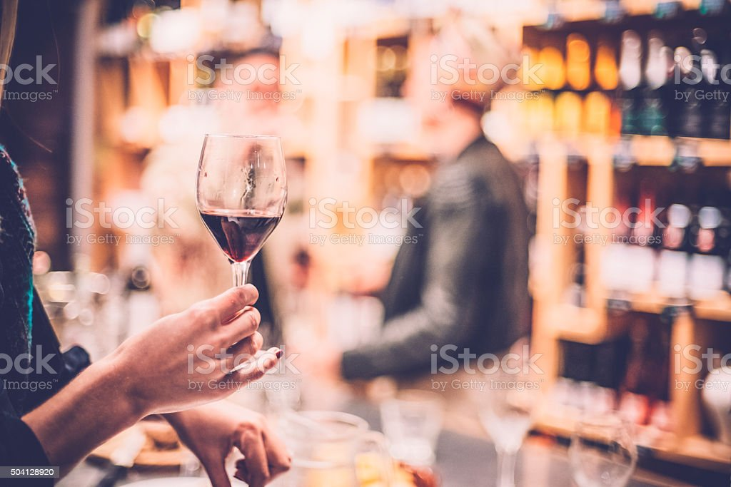 People Having Fun in a Wine Bar stock photo