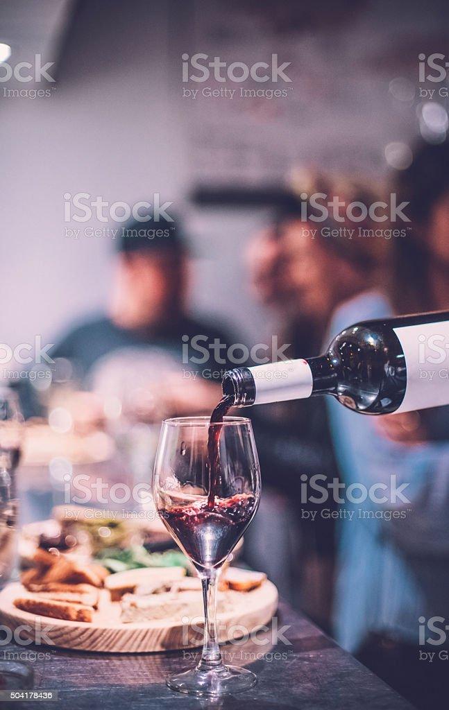 People Having Fun in a Wine Bar stock photo