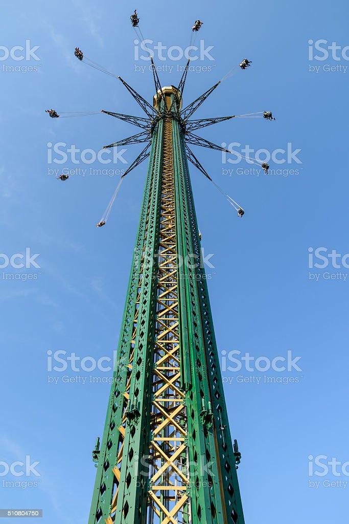 People Having Fun In Carousel At Amusement Park stock photo