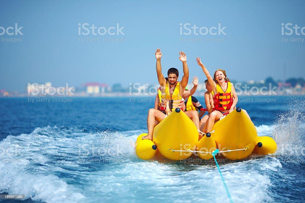 People having fun on a banana boat stock photo