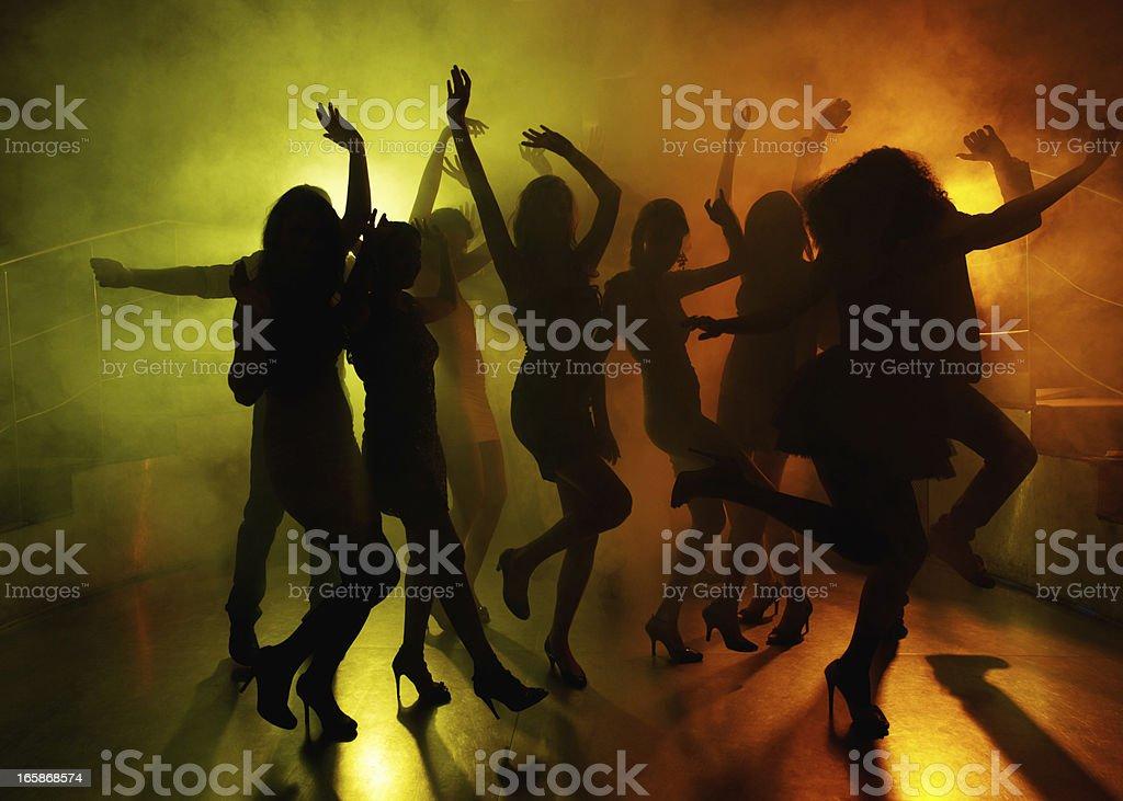 People having fun on dance floor at a night club royalty-free stock photo