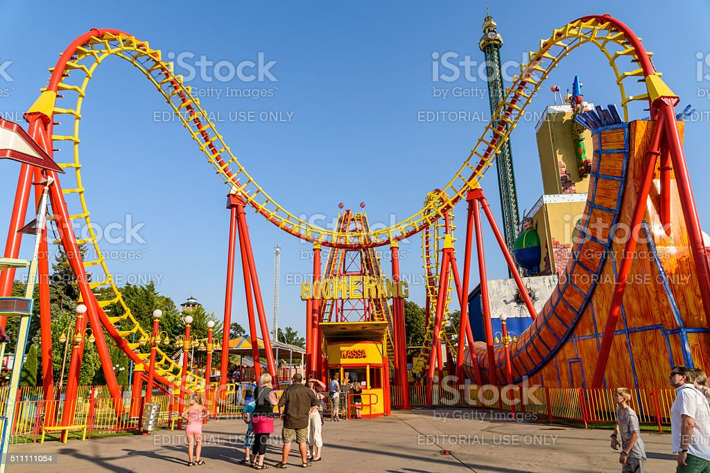 People Having Fun On Roller Coaster Ride In Prater Park stock photo
