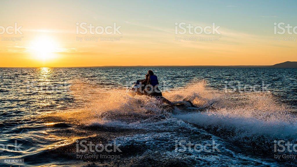 People Having Fun Riding A Jet Boat stock photo
