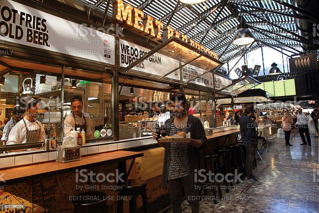 People having lunch in modern open kitchen restaurant, Tel Aviv stock photo