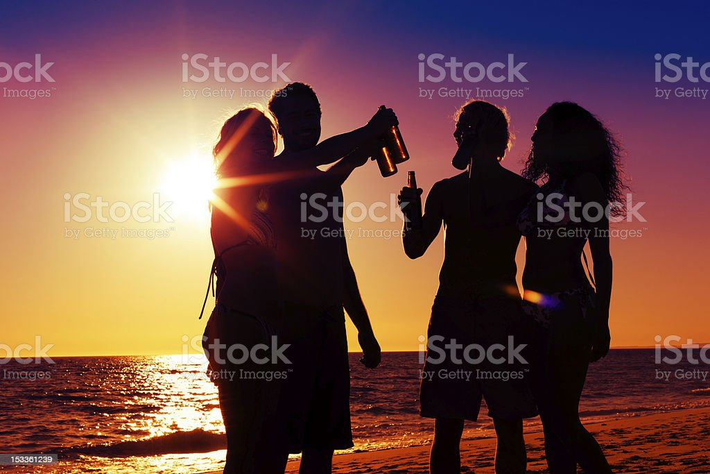 People having party at beach with drinks royalty-free stock photo