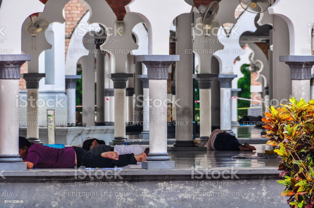 People having rest in the mosque in Kuala Lumpur, Malaysia stock photo