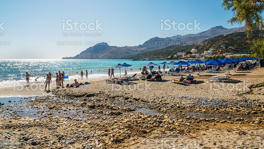 People having rest on sandy beach of Plakias stock photo