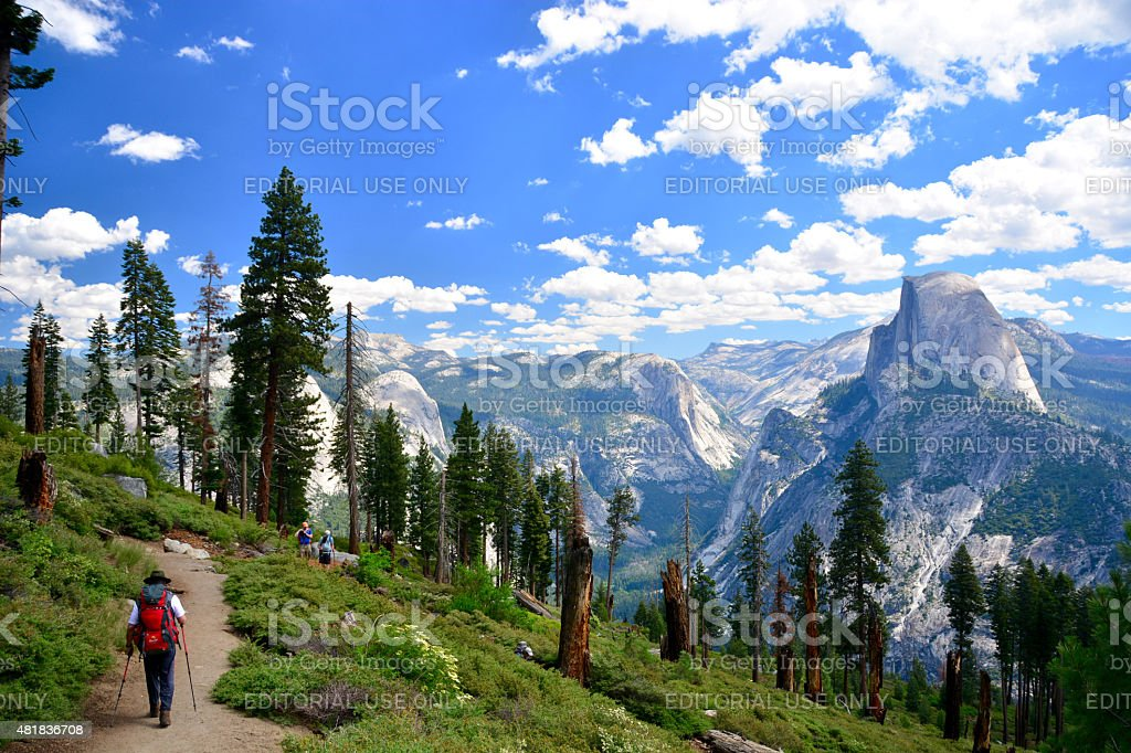 People hikers hiking in Yosemite National Park on sunny day stock photo