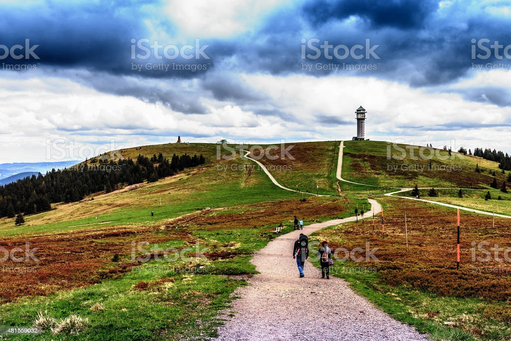 People Hiking at Feldberg Mountain in Spring stock photo