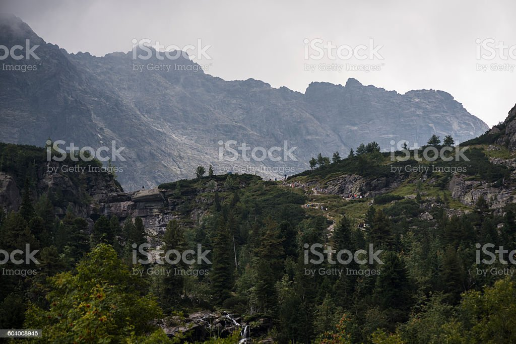 People hiking at Morskie Oko in Poland stock photo