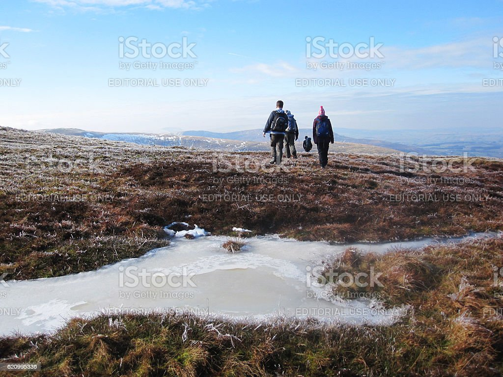 People hiking in Brecon Beacons in winter stock photo